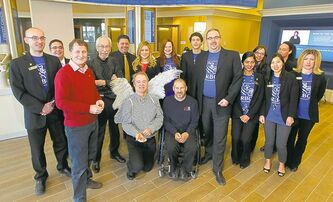 ABOVE: Kevin Rollason with his wings at the Sage Creek RBC event. Also present were Kai Madsen (left of Rollason), David Northcott (red sweater) and Jared Funk, who won silver at the Paralympics in wheelchair rugby.