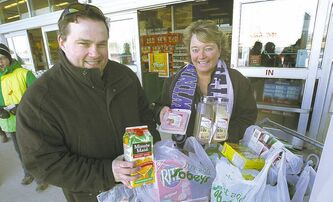 Joel Parent and Siloam Mission's Judy Richichi shop for groceries in preparation for Siloam's special Good Friday meal.