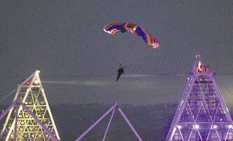 Mark Sutton parachutes into Olympic Stadium dressed as James Bond during the Opening Ceremony on July 27, 2012.
