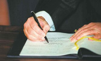 Then-prime minister Brian Mulroney signs the North American Free Trade Agreement in Ottawa on Dec. 17, 1992.