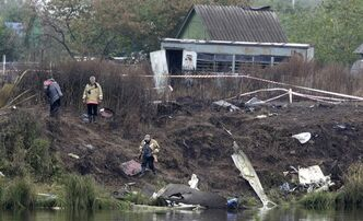 Emergency workers collect debris of the Yak-42 jet which crashed Wednesday, near Yaroslavl, 150 miles (240 kilometers) northeast of Moscow in Russia, Friday, Sept. 9, 2011. Russian air accident investigators began examining flight recorder boxes Friday . The crash killed 36 players, coaches and staff of the Lokomotiv Yaroslavl team, including European national team and former NHL players. The team had been heading to Minsk, Belarus to play its opening game of the Kontinental Hockey League season. (AP Photo/Misha Japaridze)