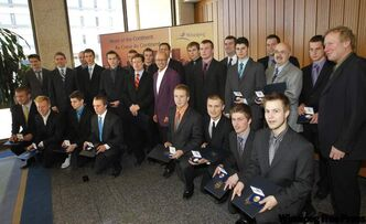 Mayor Sam Katz  (centre) presented Outstanding Achievement Award medals to the 2011 national midget hockey champion Winnipeg Thrashers  this morning in a special ceremony at City Hall. Councillor Thomas Steen is at the far right.