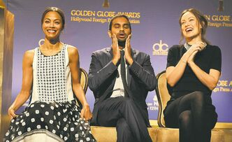 From left, Zoe Saldana, Aziz Ansari and Olivia Wilde announce the nominations for the 71st Annual Golden Globe Awards Thursday in Beverly Hills.