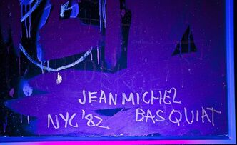 "Sotheby's says it has discovered that Jean-Michel Basquiat secretly signed one of his paintings in invisible ink. The auction house is selling ""Orange Sports Figure,"" estimated to be worth between 3 million pounds and 4 million pounds ($4.7 million and $6.3 million). Basquiat, a grafitti artist who became a New York art star, signed relatively few of his canvases. But Sotheby's said ultraviolet light revealed the artist's name and the date 1982 beneath the layers of paint. (AP Photo/Sotheby's)"
