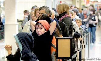 Another large lineup forms for H1N1 vaccination at the clinic in the Grant Park Shopping Centre at 10 a.m. Thursday.