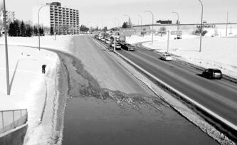 A water-main break floods Route 90 on Thursday in Winnipeg. Investments in infrastructure generate economic activity, which in turn boosts tax revenues.
