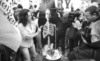 Irish Republicans burn a mock coffin of Margaret Thatcher in the Bogside area of Londonderry, Northern Ireland.