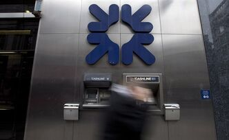 A pedestrian walks past the logo of the Royal Bank Of Scotland (RBS), in London, Feb. 28, 2013. THE CANADIAN PRESS/AP, Alastair Grant