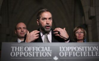 Opposition Leader and NDP Leader Thomas Mulcair holds a news conference flanked by caucus members Nathan Cullen (left) and Nycole Turme l(right)after concluding a meeting with his caucus on Parliament Hill in Ottawa Wednesday, December 12, 2012. THE CANADIAN PRESS/Fred Chartrand