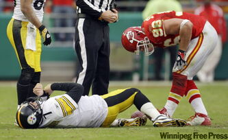 Pittsburgh Steelers quarterback Ben Roethlisberger (7) lies on the ground after being sacked by Kansas City Chiefs defensive end Andy Studebaker (96) during overtime of an NFL football game Sunday in Kansas City, Mo. The Chiefs won the game 27-24. Roethlisberger was injured on the play.