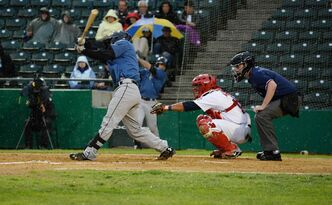 St. Paul Saints' Sam Maus misses a hit from the Goldeyes Saturday, just before the game was suspended due to rain.