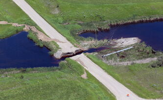 A road washout in the RM of Wallace, west of Virden on the Bosshill Creek Thursday.