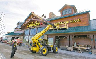 Cabela's is benefiting from the surging consumer demand for firearms in the U.S.