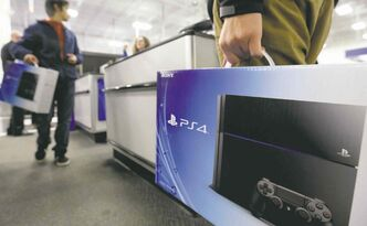 PlayStation 4 systems were flying  out of stores across North America after  going on sale  as early  as midnight  Friday.