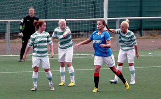 Amy Harrison (in blue) plays centre-mid for the Rangers Football Club's Ladies Senior Squad after growing up in Winnipeg and graduating from the University of Tennessee.