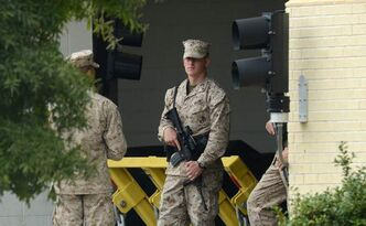 Military personnel stand watch Monday morning after the deadly shooting attack on employees at the Washington Navy Yard.