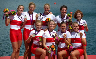 Canada's women's eight rowing team members, Hanson at far left, show silver medals.