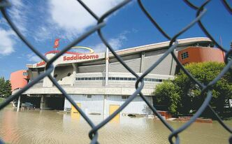 The Saddledome is surrounded by water on Sunday.