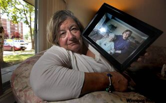 Marsha Palansky holds a portrait of herself with her mother Lilyan Peck.