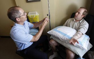 Naturopath Dr. Gordon Sims  administers a high-dose Vitamin C  IV to Glen Thompson  at the Centre for Natural Medicine.