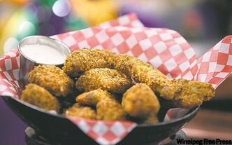 Southern deepfried pickle spears with spicy cheese sauce dip