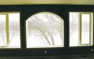 PVC windows can be built to almost any shape. Note arc over top of centre window.