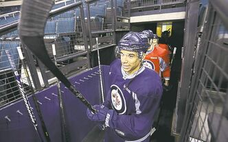 Evander Kane emerges from the dressing room for the team's open practice.