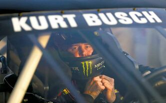 Sprint Cup Series driver Kurt Busch takes his helmet off after qualifying for Sunday�s Advocare 500 NASCAR auto race at Atlanta Motor Speedway in Hampton, Ga., Friday, Aug. 30, 2013. (AP Photo/John Bazemore)