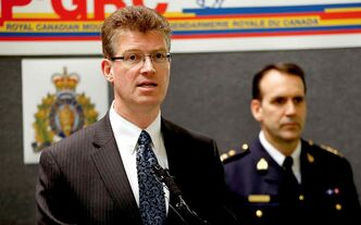 Justice  Minister Andrew Swan (left) makes the Hells Angels announcement with RCMP Assistant Commissioner Kevin Brosseau.