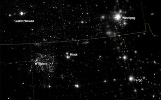 A nighttime view of northwestern North Dakota on Nov. 12, 2012, shows bright specks of light associated with drilling equipment and temporary housing near drilling sites.  NASA Earth Observatory image by Jesse Allen and Robert Simmon, using VIIRS Day-Night Band data from the Suomi National Polar-orbiting Partnership.