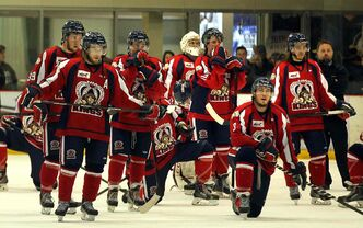 The defeated Dauphin Kings watch the Winnipeg Blues celebrate their 5-1 championship win.