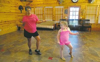Alana (Honey Boo Boo, right), with her dance coach, Amanda Carter.