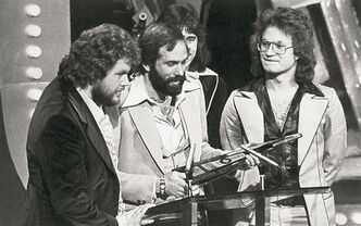 Members of Bachman-Turner Overdrive accept the third of their three Juno Awards presented to them in Toronto in 1976.