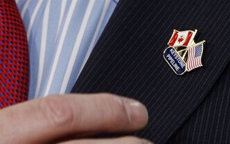 A Keystone XL pipeline lapel pin is seen in Washington, March 22, 2012. THE CANADIAN PRESS/AP, Charles Dharapak
