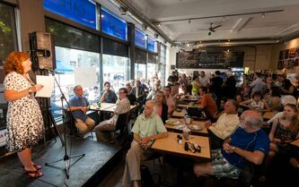 Mary Agnes Welch talks during the summit at the News Café on Tuesday night