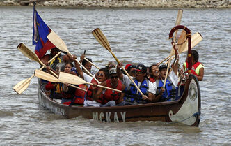 Fourteen paddlers from Pimicikamak Cree First Nation celebrate their arrival at The Forks on Friday after a grueling 19 day 890 km trip. The  Ininiwi Aski Quest advocates for the protection of Lake Winnipeg.