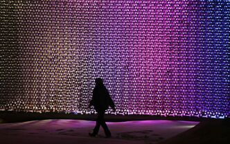 A man walks through Old Market Square past The Cube in February.