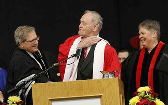 Sharing a laugh are University of Winnipeg President Lloyd Axworthy Vice-Chancellor (left) and with Justice Brenda Keyser (right) as they present former prime Minister Jean Chrétien with an honorary degree Thursday.