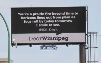 A billboard on Portage Avenue near Maryland Street shows a tweeted message.