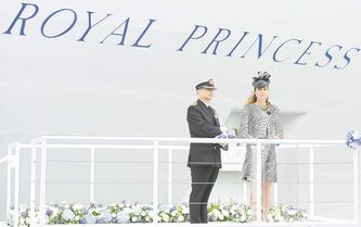 Catherine, Duchess of Cambridge (right) stands with Captain Tony Draper on the podium during a ceremony to officially name Princess Cruises's new ship Royal Princess in Southampton, England, on June 13. As the ship's godmother, the duchess officially smashed to the traditional bottle over the hull in  what is expected to her final solo engagement before the birth of her and Prince William's child.