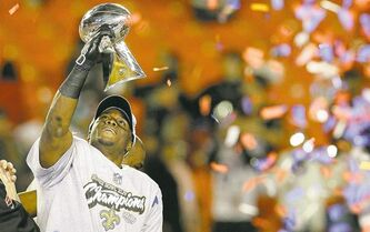 New Orleans Saints running back Reggie Bush lifts the Vince Lombardi Trophy after the Saints� 31-17 win over the Indianapolis Colts in the NFL Super Bowl XLIV football game in Miami, Sunday, Feb. 7, 2010. (AP Photo/Matt Slocum)