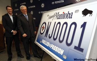 Winnipeg Jets licence plates were unveiled Tuesday at the MTS Centre by Mark Chipman (left) and Premier Greg Selinger.