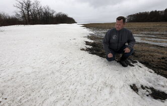 BIZ .  McRae farm near St. Andrews north on Hwy. 8  . Grain and cattle farmer CURTIS MCRAE, who is also a vice-president of the Keystone Agricultural Producers, in his field or yard that still has snow on the ground. For a story on how this year���s spring seeding season will have another  late start to the late arrival of spring, and what Manitoba farmers are planning to plant this year. (More soybeans, dry beans, sunflower seed and flaxseed, about the same amount of canola as last year, and less wheat, oats, barley and corn) Story by Murray McNeill . APRIL 24 2014 / KEN GIGLIOTTI / WINNIPEG FREE PRESS