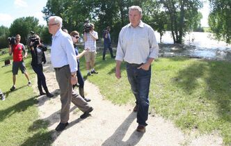 Premier Greg Selinger, left, and RM of Portage La Prairie Reeve Kam Blight tour the Portage Diversion control structure Wednesday after a press conference. The crest of the Assiniboine River is expected to hit later this afternoon.