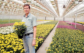Kelvin Vanderveen is part owner of Vanderveen's Greenhouses Ltd. A soaring gas bill converted him to biomass.