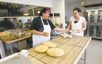 Bakers Diana Atkinson and Arlene Peebles (above) are stoked about the grand opening on March 19, and are refining their preparation techniques in the days ahead.
