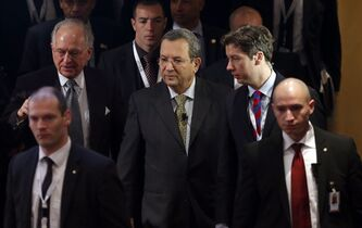 Israeli Defense Minister Ehud Barak, center, arrives for a meeting of the Security Conference in Munich, southern Germany, on Sunday, Feb. 3, 2013. The 49th Munich Security Conference started Friday until Sunday with experts from 90 delegations. (AP Photo/Matthias Schrader)