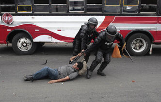 In this May 2012 photo, an injured former soldier of the Sandinista Popular Army (EPS) is detained by riot police during clashes after they blocked the entrance to the international airport along the Pan American highway to demand the government of Nicaragua's President Daniel Ortega provide them social benefits as veterans of war, in Managua, Nicaragua May 31, 2012.