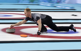 Canada's skip Brad Jacobs delivers arock during the men's curling gold medal game against Britain at the 2014 Winter Olympics, Friday in Sochi, Russia.