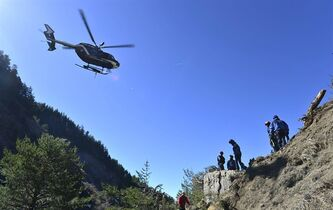 In this undated photo provided by the French Interior Ministry, French emergency rescue services work at the site of the Germanwings jet that crashed on Tuesday, March 24, 2015 near Seyne-les-Alpes, France. The co-pilot of the Germanwings jet barricaded himself in the cockpit and intentionally rammed the plane full speed into the French Alps, ignoring the captain's frantic pounding on the door and the screams of terror from passengers, a prosecutor said Thursday. (AP Photo/French Interior Ministry, Francis Pellier)